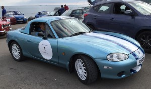 Robert Woodside Jr and his unbeatable MX5 lines up at the start.
