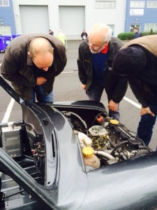 Autotest legend Ken Irwin (centre) discusses the engineering of Paul Mooney's Vauxhall Mini.