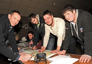 David White (Left) welcomes some new faces to DMC, and quickly explains what rally navigation is like.