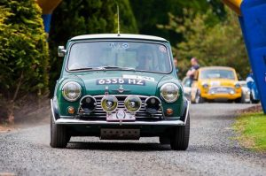 Derek and Simon Smyth pull away from the start in their 1967 Cooper S.  Photo by peeSpeed.com