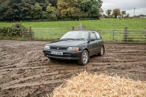Eamonn Byrne and Derek Smyth slither through the mud on test 1 . Photo: Les McMullan