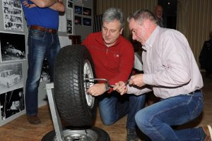 Declan Campbell and Norman Burns have a go at the wheel change.